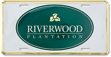 Riverwood Plantation custom embossed gold-finish aluminum license plates - detail